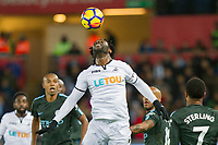 Wilfried Bony of Swansea City flicks the ball on during the EPL - Premier League match between Swansea City and Manchester City at the Liberty Stadium, Swansea, Wales on 13 December 2017. Photo by Mark  Hawkins / PRiME Media Images.