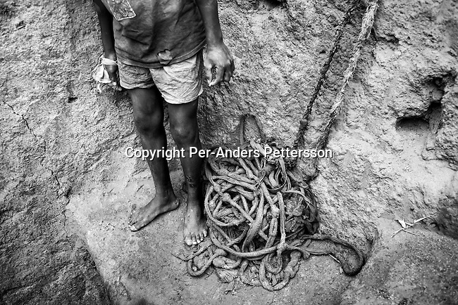 LUBUMBASHI, DEMOCRATIC REPUBLIC OF CONGO - DECEMBER 14: An unidentified young man standing near a pit at a cobalt mine on December 14, 2005 in Ruashi mine about 20 kilometers outside Lubumbashi, Congo, DRC. Children as young as eight years old work in the mine under dangerous conditions. Every month a few of the miners are killed. Congo has one of the largest Copper deposits in the world and most of it is exported to China. It?s fueling the thirst for minerals for China?s economic boom. The young men who works in the mine makes a few US dollars a day, and the children much less. The mine is about one hundred years old and has been a source of wealth for the Katanga province for many years. In recent years many foreign companies and shady business people has moved into Congo to plunder its wealth. The country has no elected government and the corruption is rife. Border and customs officials are easily bribed. Congo has had a civil war since 1997 and it?s estimated that nearly 4 million people has died in fighting and because of lack of health care..(Photo: Per-Anders Pettersson/Getty Images).
