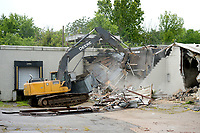 A worker with Redline Contractor in Springdale operates an excavator Friday, July 31, 2020, while demolishing the former Marvin's IGA store on 15th Street in south Fayetteville. The location closed in 2017 and is being razed. The site will be returned to a green space according to construction staff onsite. Visit nwaonline.com/200801Daily/ for today's photo gallery.<br /> (NWA Democrat-Gazette/Andy Shupe)