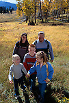 A family of five hiking in a meadow enjoying the fall afternoon in Rocky Mtn Nat'l Park, CO.