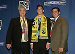 12 January 2007: Greg Dalby was taken with the second pick of the second round (15th overall) by the Columbus Crew. He is flanked by head coach Sigi Schmid (l) and General Manager Mark McCullers (r). The 2007 MLS SuperDraft was held in the Indianapolis Convention Center in Indianapolis, Indiana during the National Soccer Coaches Association of America's annual convention.