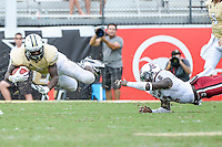 September 28, 2013 - Orlando, FL, U.S: UCF Knights running back Storm Johnson (8) is upended by South Carolina Gamecocks safety Brison Williams (12) during 2nd half NCAA football game action between the South Carolina Gamecocks and the UCF Knights. South Carolina defeated UCF 28-25 at Bright House Networks Stadium in Orlando, Fl
