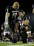 ROME, GA - DECEMBER 18: Brandon Koolstra #90 of the University of Sioux Falls consoles teammate Eric Anderson #45 after the Cougars fell to Carroll College 10-7 at Barron Stadium in the 2010 NAIA National Football Championship in Rome, GA.(photo by Dave Eggen/Inertia)
