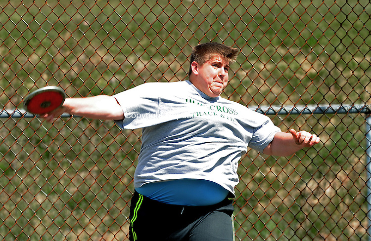 """WATERBURY, CT-10 APRIL 2012--041012JS09-Holy Cross' Sam Hunter took first in the discus with a throw of 131' 11"""" during their meet with Sacred Heart and Wilby Tuesday at Holy Cross High School in Waterbury. .Jim Shannon Republican-American"""