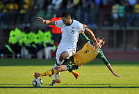 Clint Dempsey of USA is fouled by Luke Wilkshire of Australia....Football - International Friendly - USA v Australia - Ruimsig Stadium