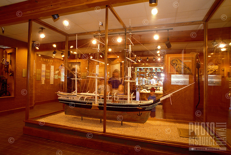 A family observes a model ship in the Whalers Village Museum in Kaanapali