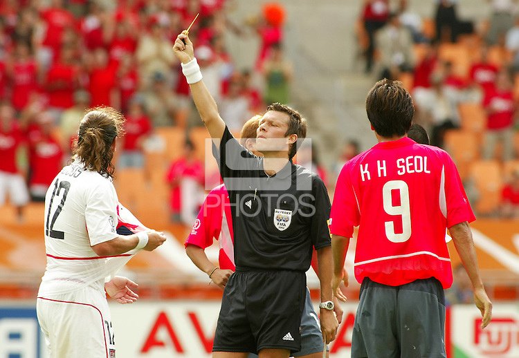 Jeff Agoos receives a yellow card during the game. The USA tied South Korea, 1-1, during the FIFA World Cup 2002 in Daegu, Korea.