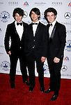 BEVERLY HILLS, CA. - October 25: Musicians Nick Jonas, Joe Jonas and Kevin Jonas of The Jonas Brothers arrive at The 30th Anniversary Carousel Of Hope Ball at The Beverly Hilton Hotel on October 25, 2008 in Beverly Hills, California.