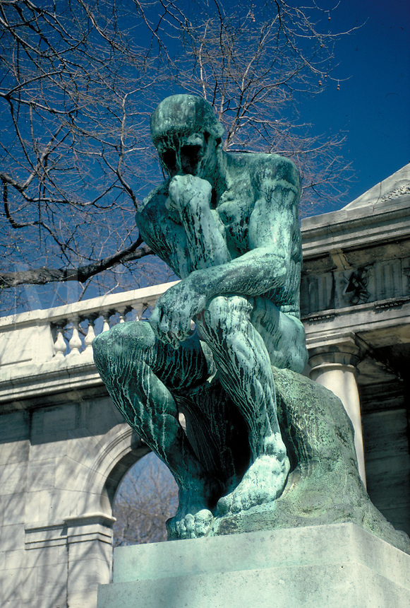 At the entrance of the Rodin stands the bronze sculpture,The Thinker. The Thinker. Philadelphia Pennsylvania United States Rodin Museum.