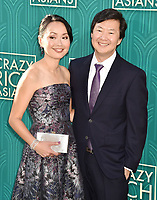 HOLLYWOOD, CA - AUGUST 07: Tran Jeong (L) and Ken Jeong arrive at the Warner Bros. Pictures' 'Crazy Rich Asians' premiere at the TCL Chinese Theatre IMAX on August 7, 2018 in Hollywood, California.<br /> CAP/ROT/TM<br /> &copy;TM/ROT/Capital Pictures