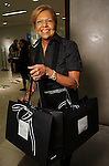 Yvonne Cormier with her bags of shoes at a Dress for Dinner event featuring shoe designer Edgardo Osorio at Saks Fifth Avenue Wednesday Oct. 28, 2015.(Dave Rossman photo)