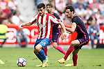 Sporting de Gijon's Nacho Cases (l) and FC Barcelona's Sergio Busquets during La Liga match. September 24,2016. (ALTERPHOTOS/Acero)