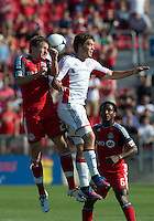 23 June 2011: Toronto FC midfielder Terry Dunfield #23 and New England Revolution midfielder Kelyn Rowe #11 in action during an MLS game between the New England Revolution and the Toronto FC at BMO Field in Toronto.