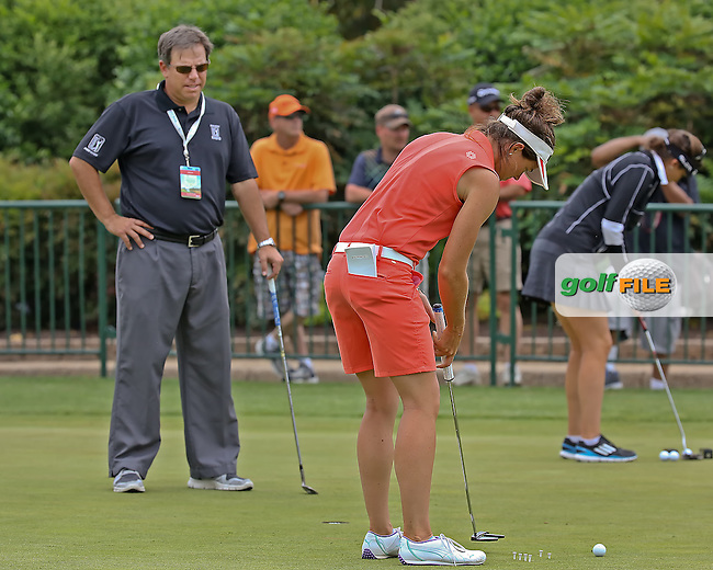 14 MAY 14  Former PGA Tour Pro Carl Paulson working on the green with French LPGA star Perrine Delacour at Wednesday's practice round at The KIngsmill Championship at The Kingsmill Resort River Course in Williamsburg, Virginia. (photo credit : kenneth e. dennis/kendennisphoto.com)