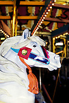 California: Santa Cruz.   Loof carved horses on Carousel..Photo: cacruz104..Photo copyright Lee Foster, 510/549-2202, lee@fostertravel.com, www.fostertravel.com..Photo #: cacruz104
