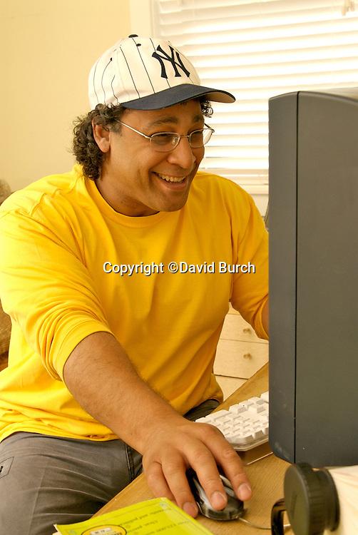 Cheerful man working on computer