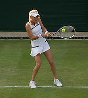 Agnieszka Radwanska<br /> <br /> Tennis - The Championships Wimbledon  - Grand Slam -  All England Lawn Tennis Club  2013 -  Wimbledon - London - United Kingdom - Tuesday 25th June  2013. <br /> &copy; AMN Images, 8 Cedar Court, Somerset Road, London, SW19 5HU<br /> Tel - +44 7843383012<br /> mfrey@advantagemedianet.com<br /> www.amnimages.photoshelter.com<br /> www.advantagemedianet.com<br /> www.tennishead.net