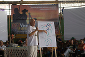 Altamira, Brazil. Encontro Xingu protest meeting about the proposed Belo Monte hydroeletric dam and other dams on the Xingu river and its tributaries. Professor Oswaldo Seva explaining the effects of the proposed dams on the Xingu River.