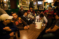 A group of locals chilling out with their privately hired &quot;Trio&quot; at Hussong&acute;s cantina. <br /> <br /> In northern mexico bands known as &quot;trios&quot; are well known for their services, private playings. In restaurants, bars or in the street is often see them offering songs, from traditional mexican music like mariachis, banda, corridos to classic rock.