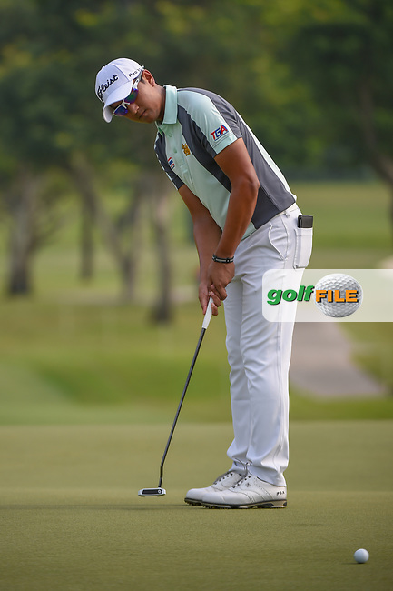 Sadom KAEWKANJANA (THA) watches his putt on 11 during Rd 2 of the Asia-Pacific Amateur Championship, Sentosa Golf Club, Singapore. 10/5/2018.<br /> Picture: Golffile | Ken Murray<br /> <br /> <br /> All photo usage must carry mandatory copyright credit (© Golffile | Ken Murray)