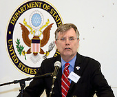 Patrick Kennedy, Under Secretary of Management, from the United States Department of State, addresses an audience of personnel from the Department of State, MRI Global, Paul Allen Foundation, and members of the 94th Airlift Wing, at an unveiling of the Department of State Containerized Biocontainment System, held at Dobbins Air Reserve Base, Georgia, August 11, 2015. <br /> Mandatory Credit: Donald Peek / USAF via CNP