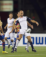 New England Revolution forward Ilija Stolica (9) attempts to control the ball as Monarcas Morelia defender Mauricio Romero (26) pressures. Monarcas Morelia defeated the New England Revolution, 2-1, in the SuperLiga 2010 Final at Gillette Stadium on September 1, 2010.