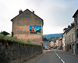 FRANCE, Salin-les-Baines, cheese mural on the side of a building at the entrance into town, Jura Wine Region