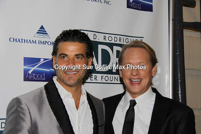 John Guerra & Carson Kressley at Broadway Takes the Runway which benefits Al D. Rodriguez Liver Foundation on October 4, 2010 at Touch, New York City, New York. (Photo by Sue Coflin/Max Photos)