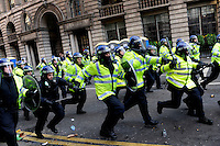 UK. London. 1st April 2009.. police charge demonstrators at the bank of england.©Andrew Testa for the New York times