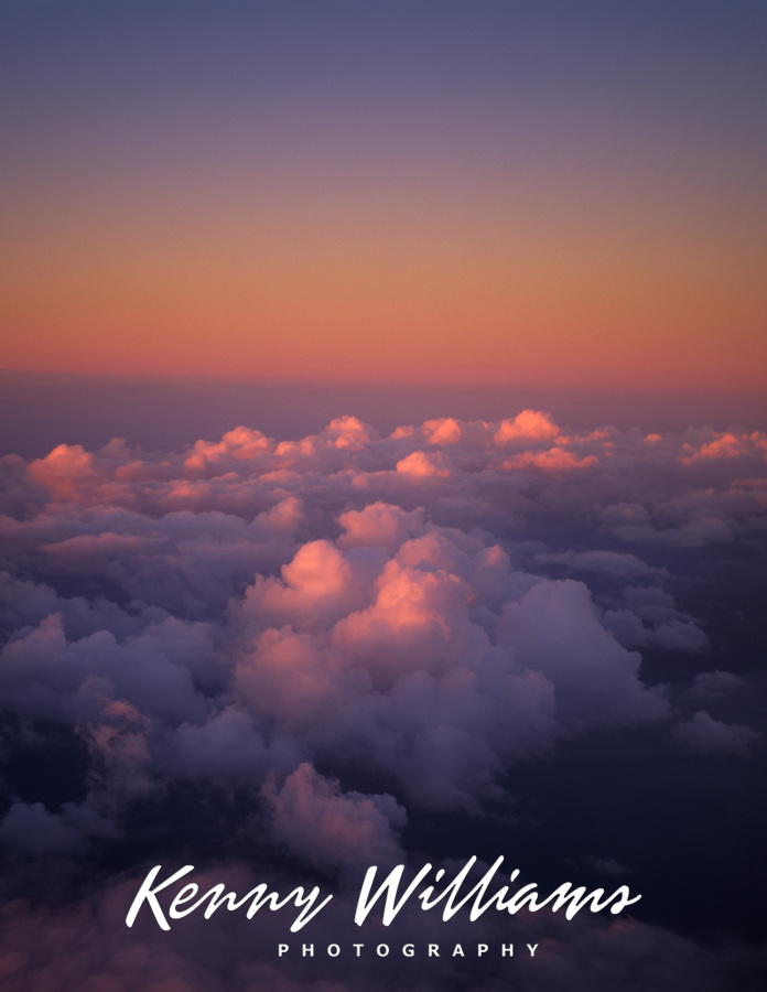Dreamy Aerial View of Clouds at twilight over Pacific Ocean near Hawaii, USA.