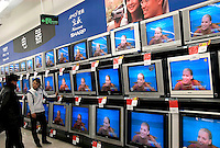 TV sets in a newly opened Wal-Mart Supercenter in Harbin, Heilongjiang province, China..27-DEC-04