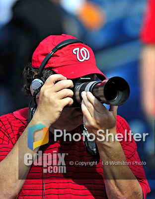 8 June 2010: A Wasington Nationals fan takes photos while listening to a radio broadcast of a game against the Pittsburgh Pirates at Nationals Park in Washington, DC. The Nationals defeated the Pirates 5-2 in the series opener where pitching sensation Stephen Strasburg made his Major League debut, striking out 14 batters and notching his first win in the majors. Mandatory Credit: Ed Wolfstein Photo