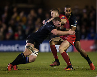 Scarlets&rsquo; Tom Prydie is tackled by Bath Rugby's Sam Underhill and Aled Brew<br /> <br /> Photographer Bob Bradford/CameraSport<br /> <br /> European Champions Cup Round 5 - Bath Rugby v Scarlets - Friday 12th January 2018 - The Recreation Ground - Bath<br /> <br /> World Copyright &copy; 2018 CameraSport. All rights reserved. 43 Linden Ave. Countesthorpe. Leicester. England. LE8 5PG - Tel: +44 (0) 116 277 4147 - admin@camerasport.com - www.camerasport.com