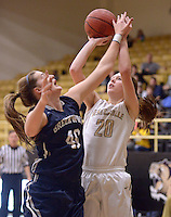 NWA Democrat-Gazette/BEN GOFF @NWABENGOFF<br /> Maren Johnston (20) of Bentonville makes a shot over Madi Pfeifer of Greenwood on Thursday Dec. 17, 2015 during the game in Bentonville's Tiger Arena.