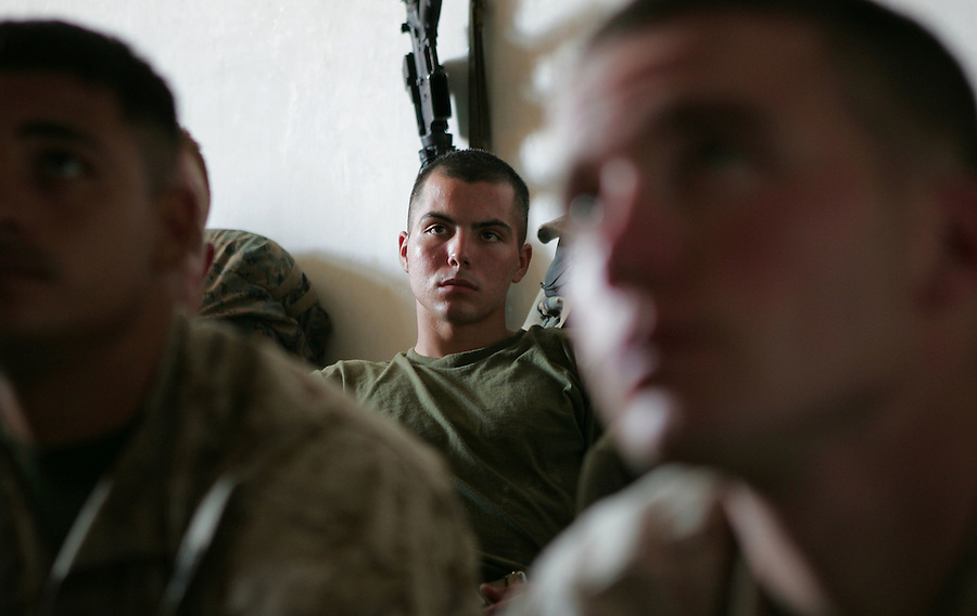 Lcpl. Christopher Marquez (center) and the Marines of 2nd Platoon Kilo Co. 3rd Battalion 1st Marines (3/1) receive the brief detailing the imminent offensive against the insurgent city of Haditha, Iraq on Sun. Oct. 2, 2005.