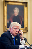 United States President Donald Trump speaks on the phone with Prime Minister of Australia, Malcolm Turnbull in the Oval Office on January 28, 2017 in Washington, DC, The call was one of five calls with foreign leaders scheduled for Saturday.  <br /> Credit: Pete Marovich / Pool via CNP