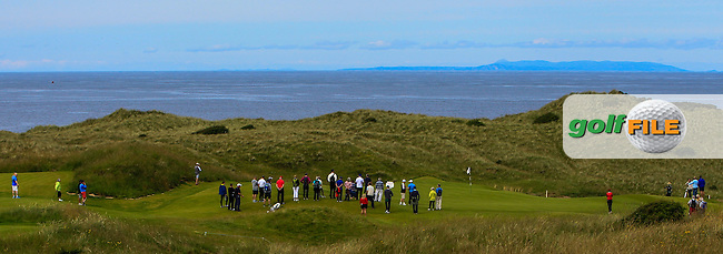 A crowd around the 13th green during the 1/4 Finals of Matchplay in the North of Ireland Amateur Open Championship at Portrush Golf Club, Portrush on Thursday 14th July 2016.<br /> Picture:  Thos Caffrey / www.golffile.ie