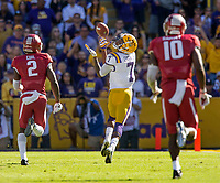 NWA Democrat-Gazette/BEN GOFF @NWABENGOFF<br /> DJ Chark (7), LSU wide receiver, catches a pass as he runs away from Kamren Curl (2), Arkansas cornerback, and Randy Ramsey (10), Arkansas linebacker, for a touchdown in the fourth quarter, Saturday, Nov. 11, 2017 at Tiger Stadium in Baton Rouge, La.
