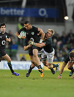 10.11.2012. Dublin, Ireland.  Simon Zebo, Ireland, is tackled by Jean de Villiers, South Africa during the Guiness Series 2012 Rugby match between Ireland and South Africa from the Aviva Stadium