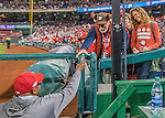 13 October 2016: Washington Nationals Manager Dusty Baker hands out armbands to fans prior to Game 5 of the NLDS against the Los Angeles Dodgers at Nationals Park in Washington, DC. The Dodgers edged out the Nationals 4-3, to take Game 5 of the Series, 3 games to 2, and move on to the National League Championship Series against the Chicago Cubs. Mandatory Credit: Ed Wolfstein Photo *** RAW (NEF) Image File Available ***