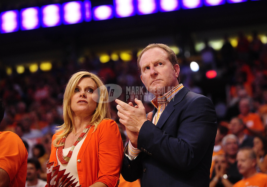 "May 5, 2010; Phoenix, AZ, USA; Phoenix Suns owner Robert Sarver (right) with wife Penny Sarver against the San Antonio Spurs in game two in the western conference semifinals of the 2010 NBA playoffs at the US Airways Center. The team is wearing ""Los Suns"" jerseys on Cinco de Mayo in response to an anti-immigration law recently passed in Arizona. Mandatory Credit: Mark J. Rebilas-"