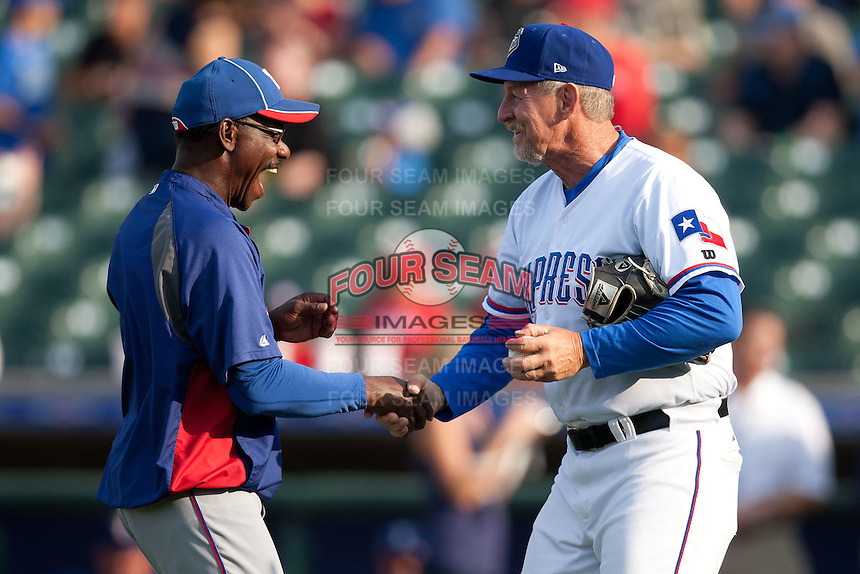 "Texas Rangers manager Ron Washington #38 smiles and greets Round Rock Express manager Bobby Jones #31 before the MLB exhibition baseball game against the ""AAA"" Round Rock Express on April 2, 2012 at the Dell Diamond in Round Rock, Texas. The Rangers out-slugged the Express 10-8. (Andrew Woolley / Four Seam Images)."
