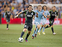 Mauro Rosales. Sporting Kansas City won the Lamar Hunt U.S. Open Cup on penalty kicks after tying the Seattle Sounders in overtime at Livestrong Sporting Park in Kansas City, Kansas.