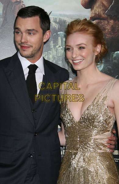 "Nicholas Hoult & Eleanor Tomlinson.""Jack The Giant Slayer"" Los Angeles Premiere held at Grauman's Chinese Theatre, Hollywood, California, USA..February 26th, 2013.half length dress cleavage gold metallic beads beaded black tie white shirt blue suit jacket stubble facial hair .CAP/ADM/RE.©Russ Elliot/AdMedia/Capital Pictures."