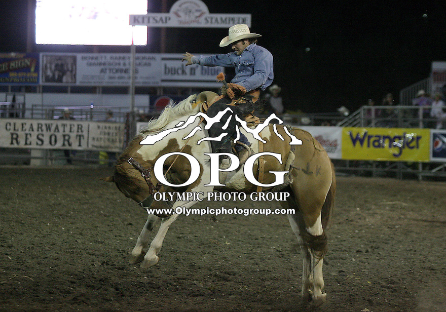 "28 Aug 2010:  Jace Garrett riding the horse Vanilla Twist scored a 81 in the Saddle Bronc Riding competition at the Kitsap County Stampede Wrangle Million Dollar PRCA Silver Rodeo Tour Bremerton, Washington. Saturday night was ""TUFF ENOUGH TO WEAR PINK"" for support of Breast Cancer awareness."