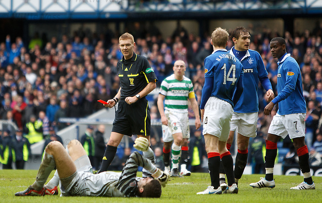 Referee Calum Murray has no hesitation in awarding a penalty kick to Rangers and sending off stricken keeper Fraser Forster