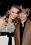 "HOLLYWOOD, CA. - February 24: Actors Emily Osment and Jason Earles arrive at the Los Angeles premiere of ""Jonas Brothers: The 3D Concert Experience"" at the El Capitan Theatre on February 24, 2009 in Los Angeles, California."