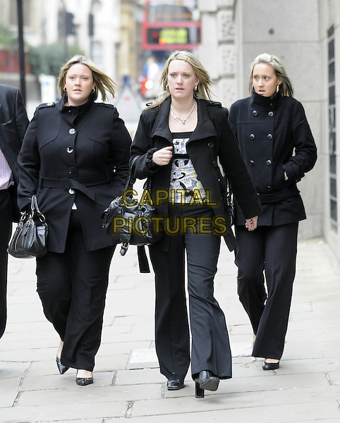DANIELLE, MICHELLE & NICOLE BOWMAN.(Sisters of Sally Ann Bowman) .Arrive at The Old Bailey, London, England..Aspiring model, Sally Ann Bowman's body was found in Blenheim Crescent, Croydon, London in September 2005. Mark Dixie was sentenced to life in prison and will serve a minimum of 34 years for her Sally Ann's murder..February 22nd, 2008.full length black coat jacket trousers siblings family.CAP/DH.©David Hitchens/Capital Pictures