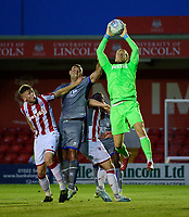 Stoke City's Adam Davies claims a high ball under pressure from Lincoln City's Matt Rhead<br /> <br /> Photographer Chris Vaughan/CameraSport<br /> <br /> Football Pre-Season Friendly - Lincoln City v Stoke City - Wednesday July 24th 2019 - Sincil Bank - Lincoln<br /> <br /> World Copyright © 2019 CameraSport. All rights reserved. 43 Linden Ave. Countesthorpe. Leicester. England. LE8 5PG - Tel: +44 (0) 116 277 4147 - admin@camerasport.com - www.camerasport.com