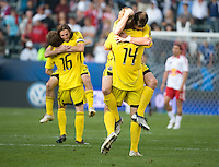Danny O'Rourke, right,  jumps into the arms of Chad Marshall (14) as Frankie Hejduk celebrates with Brian Carroll, (16) after winning the MLS Cup 2008. Columbus Crew 3-1 over the  New York Red Bulls, Sunday, November 23, 2008.